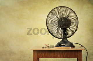 Old electric fan on table with retro look