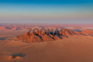 Aerial view of mountains and sanddunes Sosusvlei in background. Sossusvlei