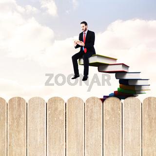 Composite image of businessman reading