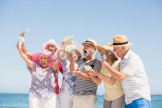 Senior friends holding money