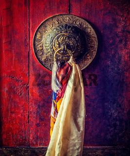 Door gates handle of Thiksey gompa Tibetan Buddhist monastery