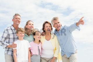 Multi generation family looking away