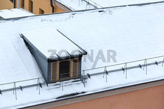 dormer on snowy roof