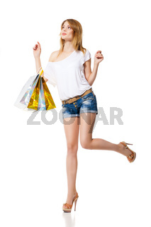 Happy smiling woman with shopping bags isolated