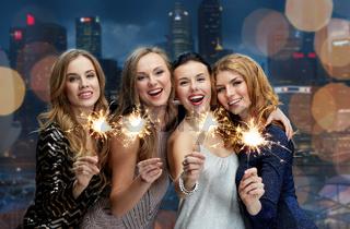 happy young women dancing at night club disco