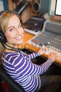 Happy young radio host in studio