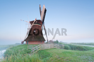 Dutch windmill in misty morning