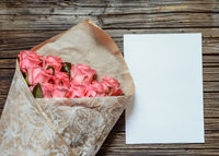 Pink roses with blank paper and colored pencil
