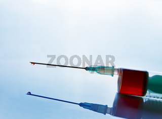 Syringe with blood sampling front tilt view blue