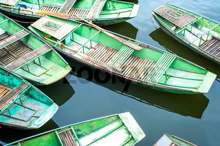 Vietnamese boats at river. Ninh Binh, Vietnam