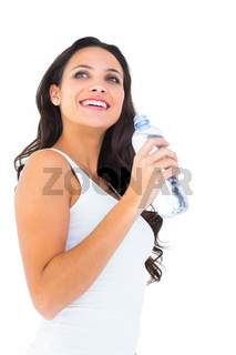 Pretty brunette drinking bottle of water