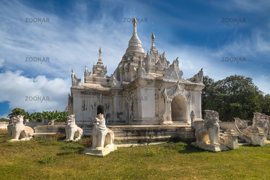 White Pagoda at Inwa city with lions guardian statues. Myanmar (Burma)