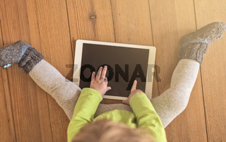 Toddler touching tablet