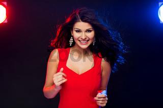 beautiful sexy woman in red dancing at nightclub
