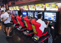 teenagers play in amusement arcade, Bangkok, Thailand