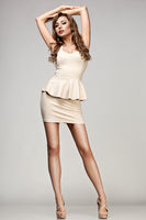 beautiful woman in beige dress