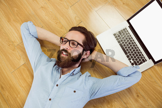 Handsome hipster using his laptop