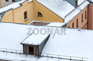 roofs of urban houses in snow