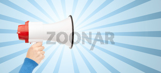 woman hand holding megaphone over blue burst rays