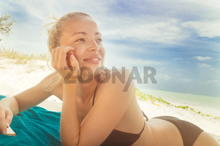 Happy woman in bikini on the beach.
