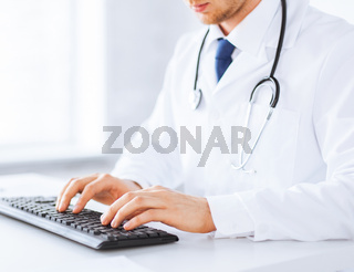 male doctor typing  on the keyboard