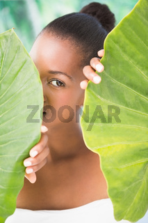 Pretty woman looking through leaves