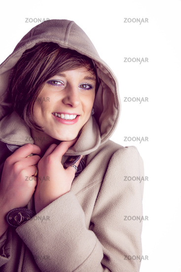 Attractive woman wearing a warm coat with hood raised