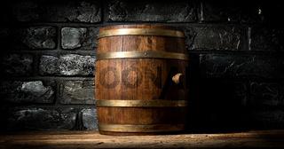 Barrel and brick wall