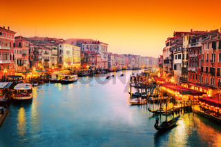 Venice, Italy. Gondola floats on Grand Canal at sunset