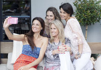 Female Friends Taking Selfie Outdoors