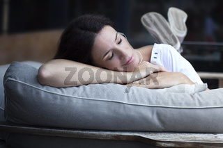 Happy adult latin woman sleeping outdoors