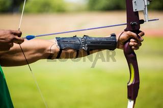 Athletes hand practicing archery
