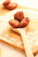 Desi Indian snack tikki/cutlet kept on wooden spoon, selective focus, food concept