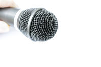 Microphone with holding arm isolated on white background
