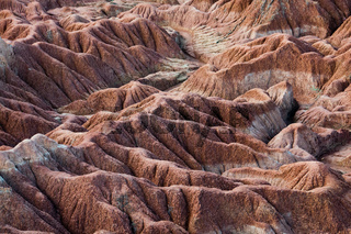 Drought red orange sand stone rock formation in Tatacoa desert, Huila