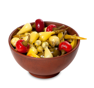 Mix of hot turkish marinated peppers in ceramic bowl