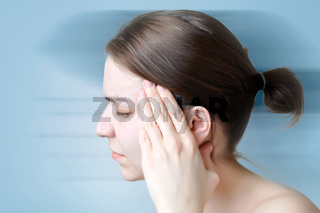 Young woman touching her head