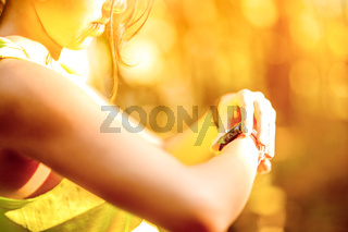 Close up image of young woman checking time
