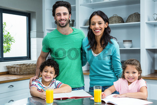 Smiling family in the kitchen