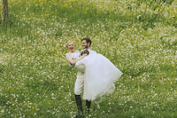 Garden Wedding groom carrying his bride
