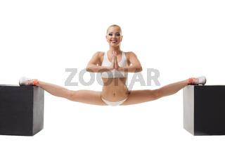 Erotic sport. Sexy girl doing gymnastic split