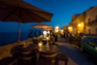 Seaside bar, defocused night scene