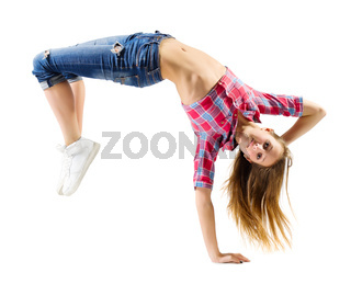 Young girl in jeans modern dancer isolated