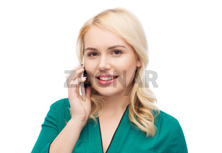 happy young woman calling on smartphone