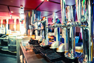 Shiny beer taps in a row