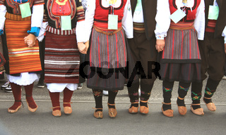 folklore group from Serbia dressed in traditional clothing is preforming Serbian national dances.