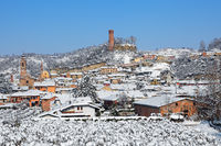 Small town and medieval tower covered with snow.