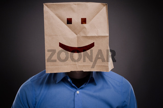 Businessman with a smiling face on a paper bag