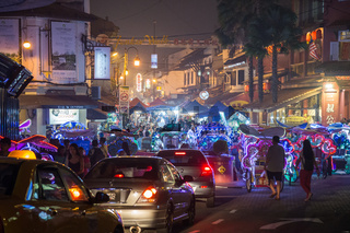 Street traffic people and market in Malacca Malaysia by night