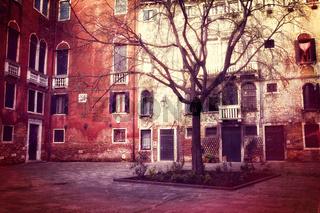 Retro style photo of small square in Venice
